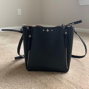 A bucket bag with zips